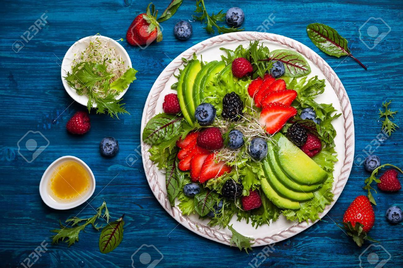 Mixed salad leaves with berries, avocado and honey-mustard dressing - 52850868