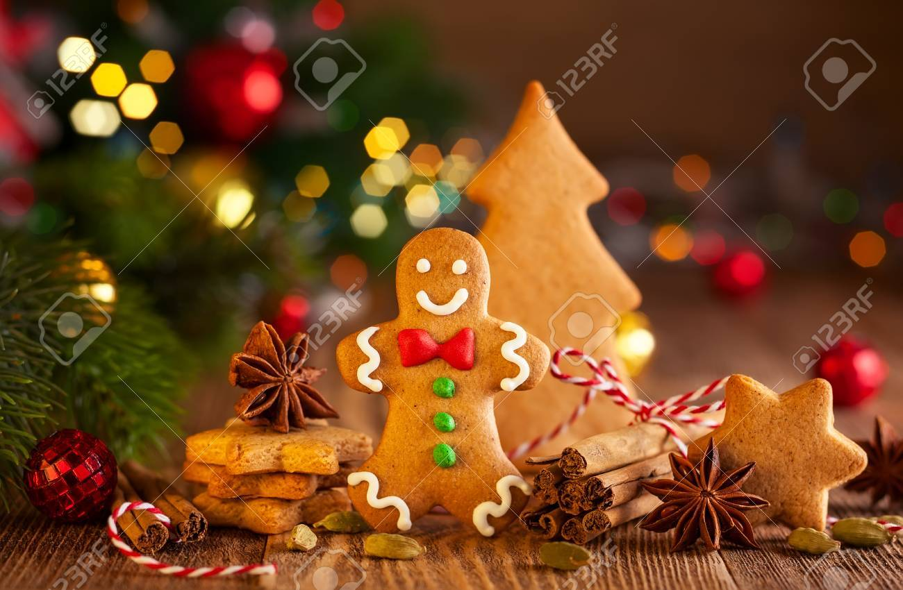 Christmas homemade gingerbread cookies and spices on the wooden background - 87322926