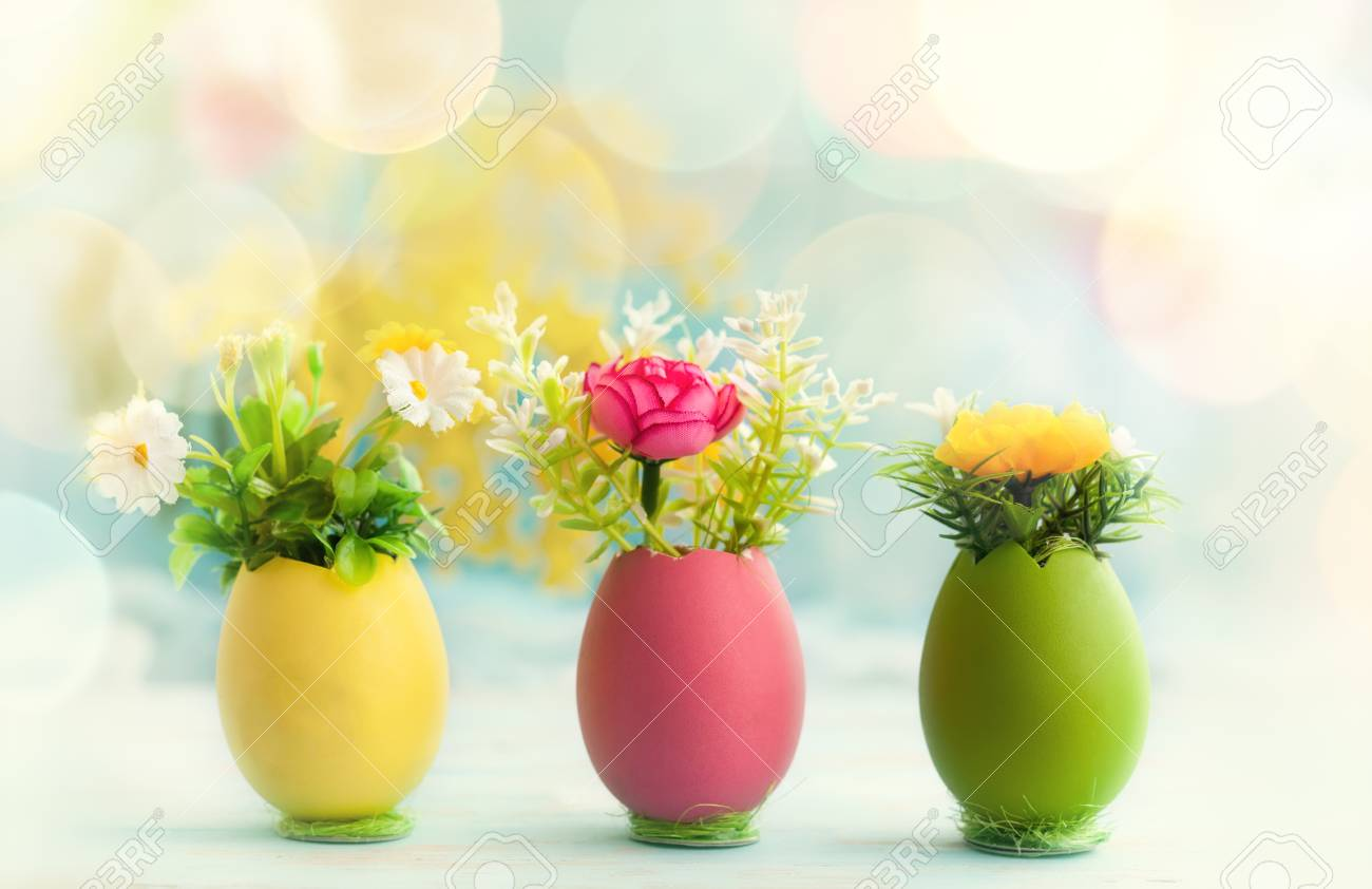 Easter Holiday Concept With Spring Flowers In Colorful Dyed Eggs