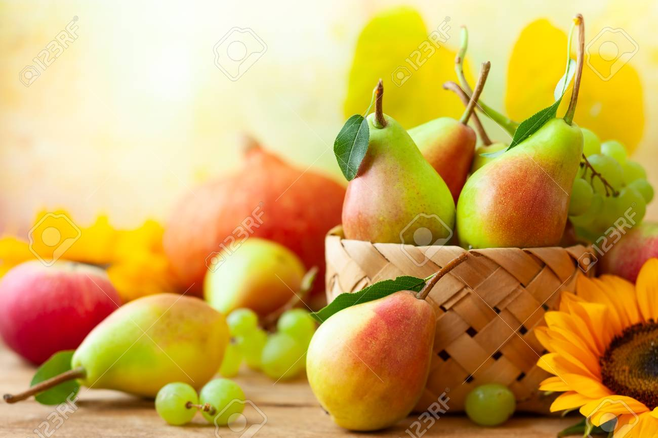 Autumn still life with seasonal fruits,flowers and vegetables on wooden background. - 107207129