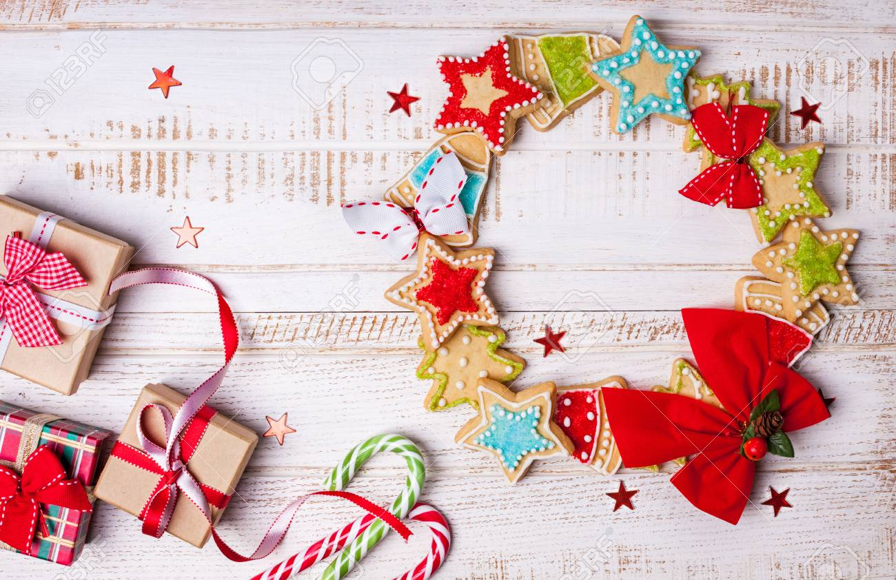 Christmas Cookies, Gift Boxes And Candy Canes On Wooden Background ...