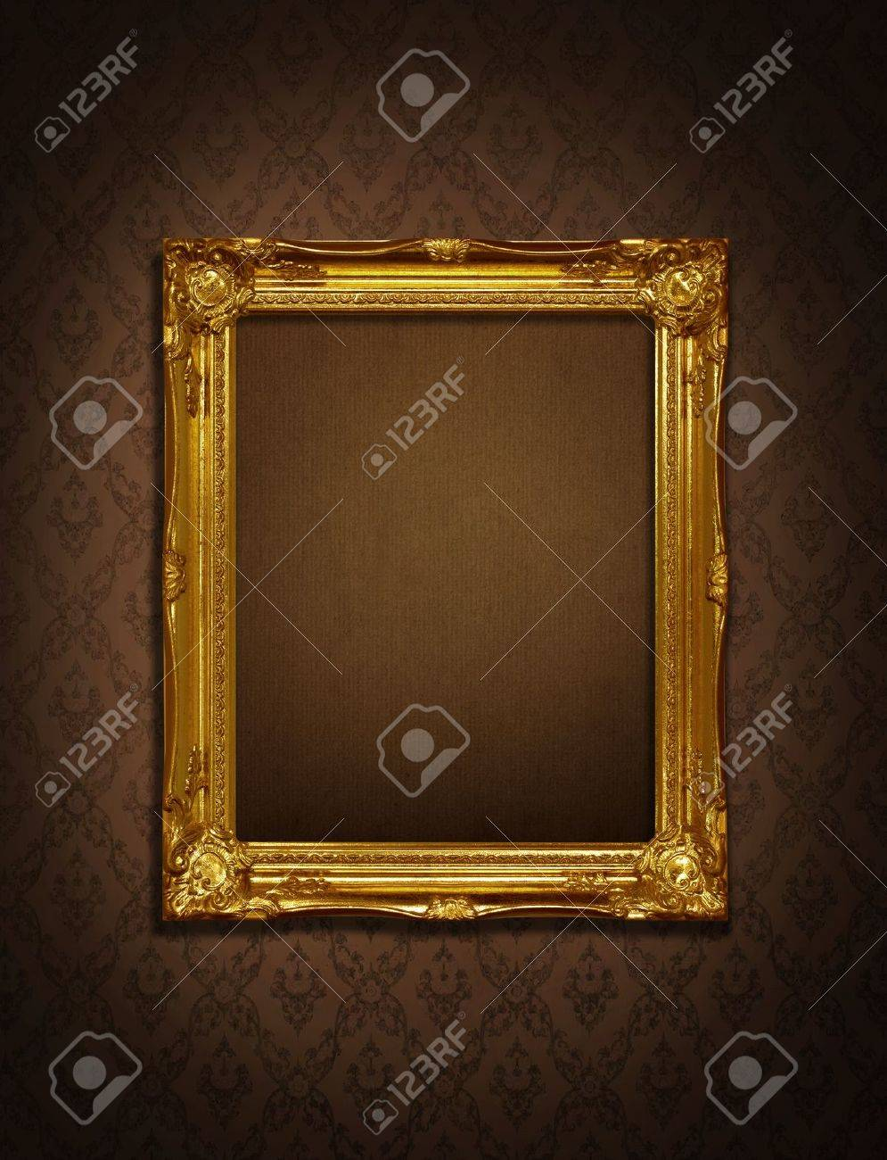 Gold frame stuck on the wall wallpaper thai the dark. Stock Photo - 9868285