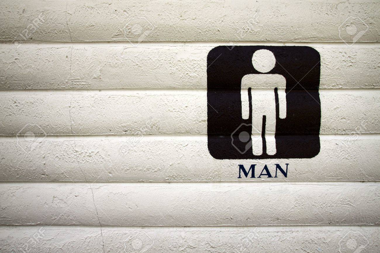 Men bathroom sign. The black paint on concrete walls. Stock Photo - 9868258