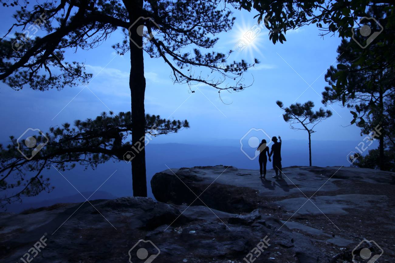 Silhouette of couple on tourists. When sunrise Stock Photo - 9868288