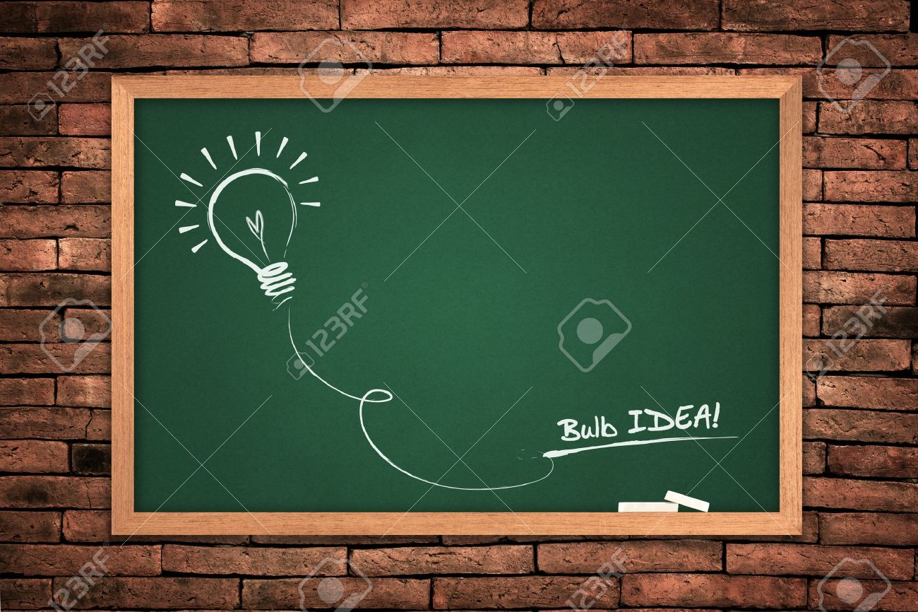 Drawing of a bulb idea green blackboard on wall background. Stock Photo - 10311466