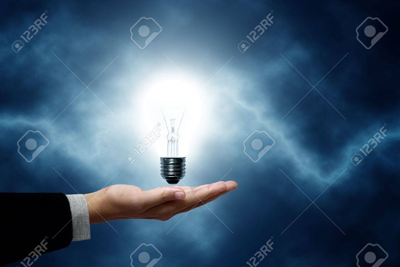 Light Bulb Hanging On Business Men The Background Is A Blue Lightning Bolt Stock Photo