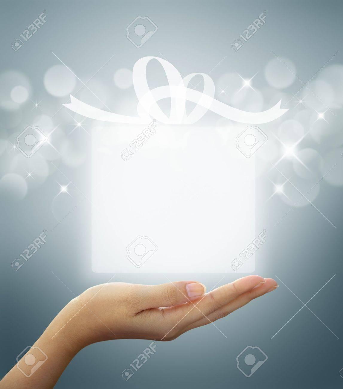 gift box Translucent white on woman hand Stock Photo - 11670806