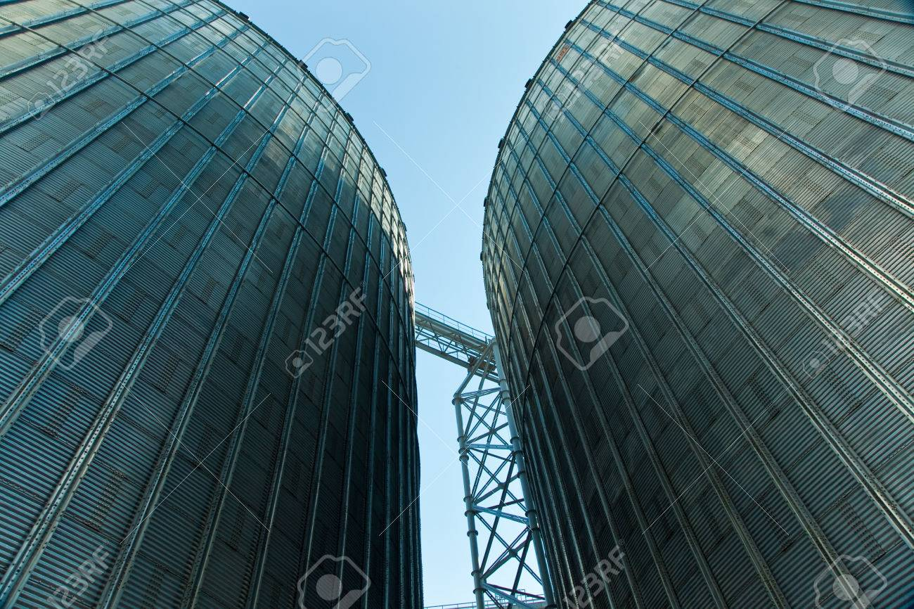 Towers of grain drying enterprise. metal grain facility with silos Standard-Bild - 35843498
