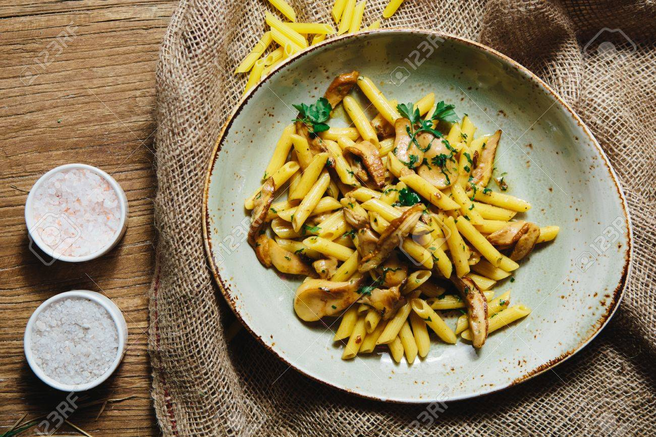 Pasta Penne With Mushrooms Grilled In Sour Cream Sauce Stock Photo