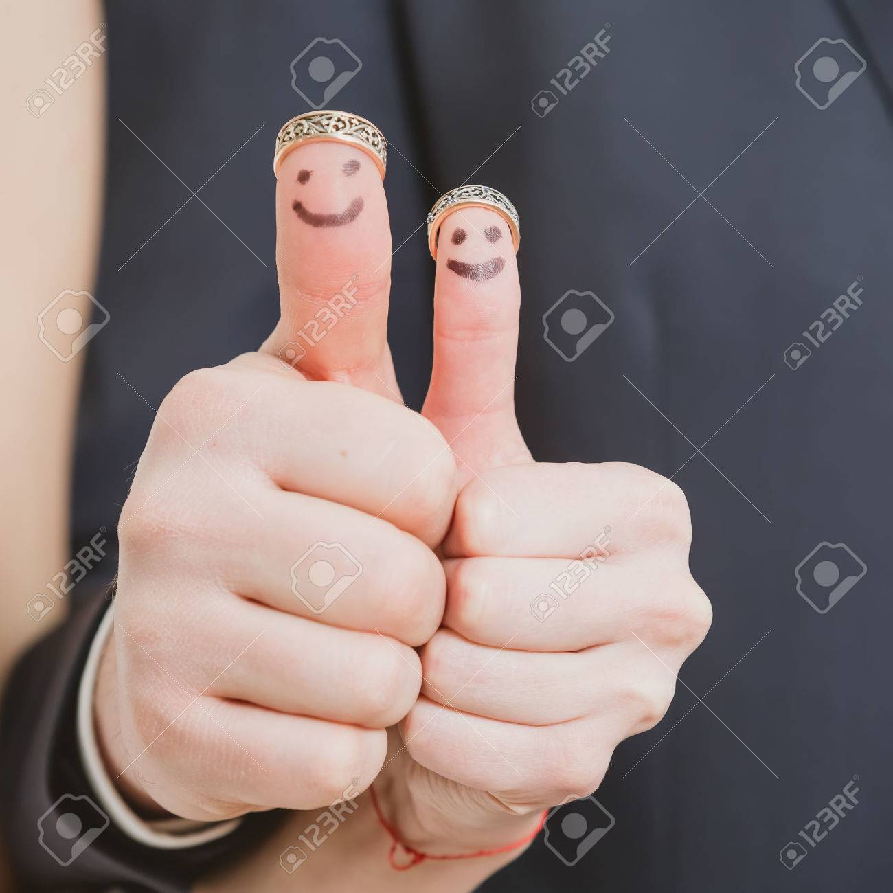 Stock Photo  Wedding Rings On Their Fingers Painted With The Bride And  Groom, Funny Little People Conceptual Idea