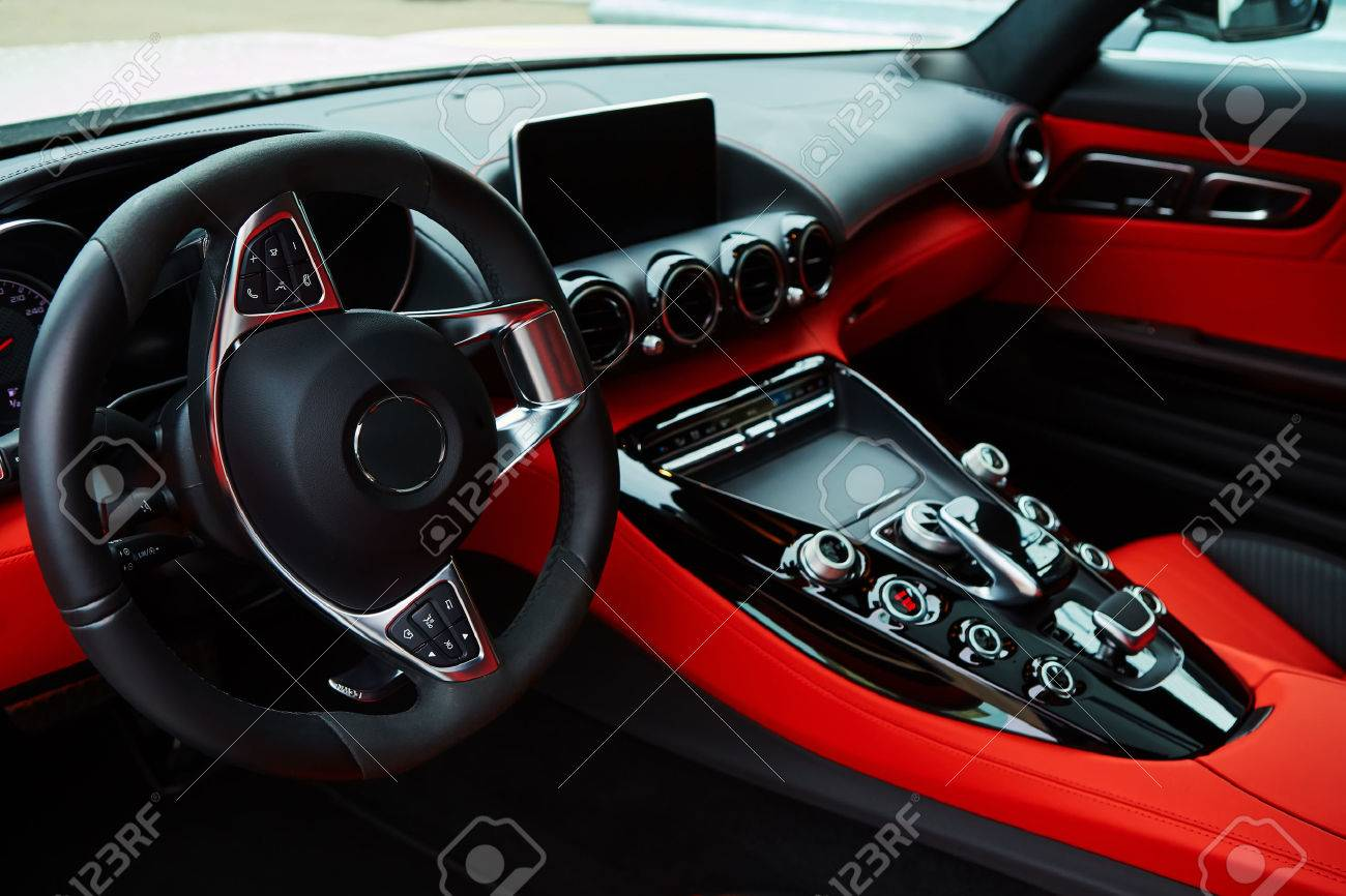 Luxury car Interior. Steering wheel and dashboard - 63636073