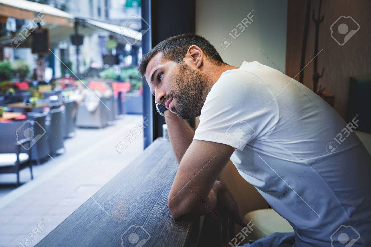 Man thinking by the bar window - 54033796
