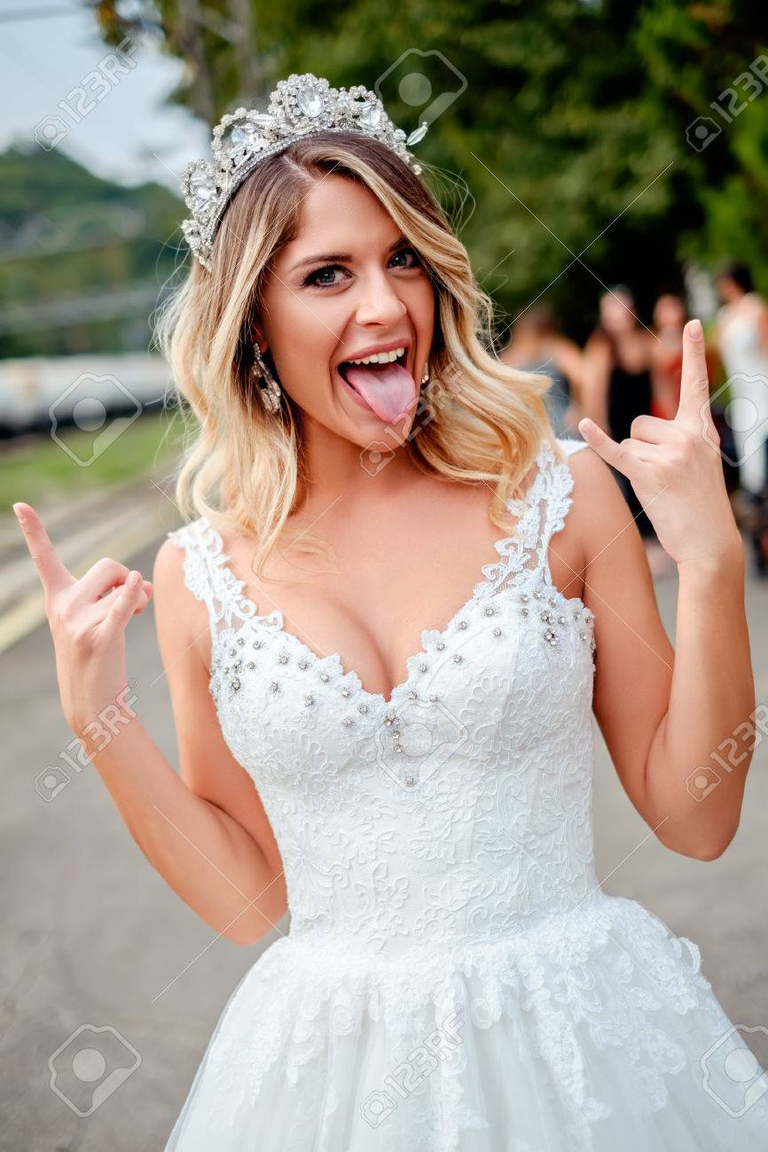 Bride Making Rock N Roll Hand Sign And Making Silly Faces Stock ...