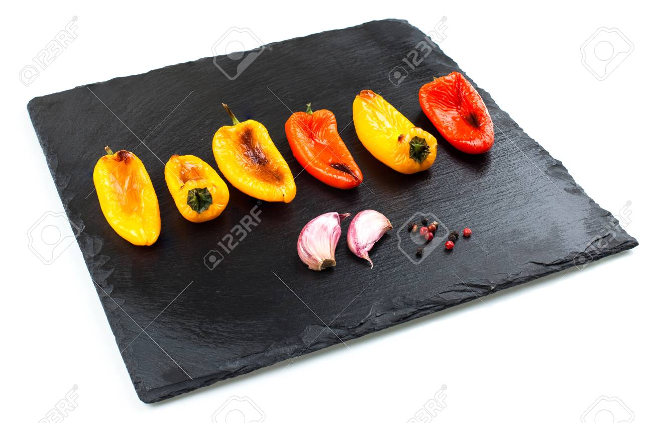 Red and yellow peppers grilled on olive oil Stock Photo - 58036444