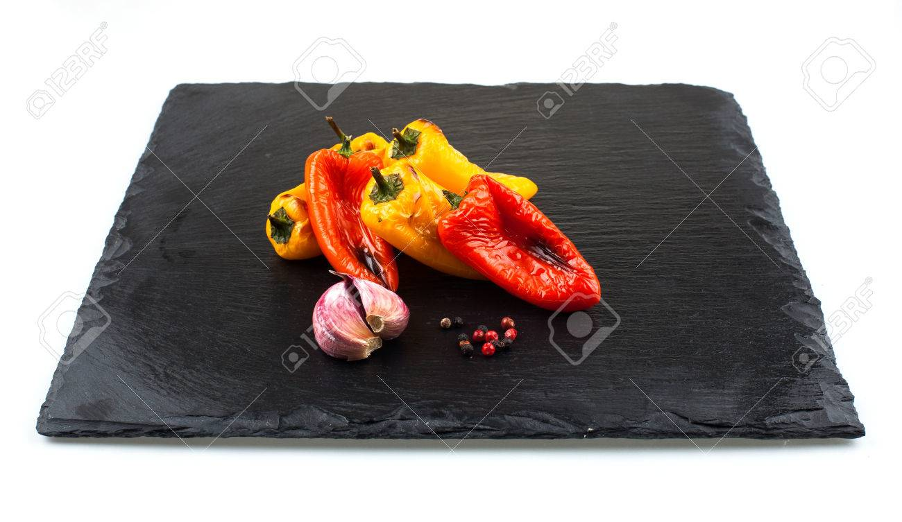 Red and yellow peppers grilled on olive oil Stock Photo - 58036445