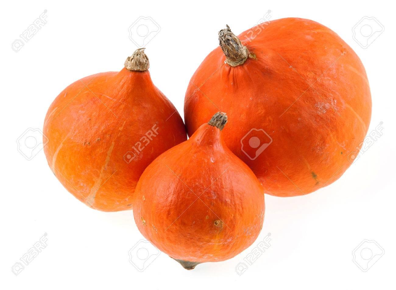 Three Hokaido pumpkins isolated Stock Photo - 64001729