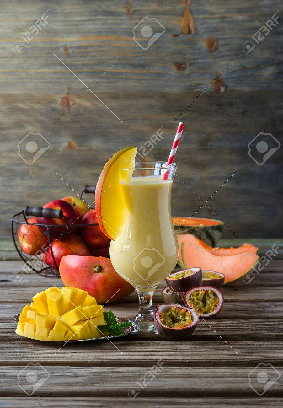 Healthy diet tropical mango melon and passion fruit smoothie with yogurt for breakfast vitamin drink - 41905837