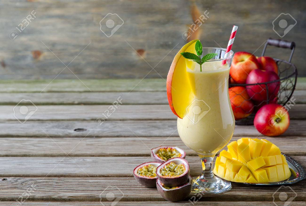 Healthy vitamin tropical mango and passion fruit smoothie with yogurt and peaches, milkshake, copy space background - 41905909