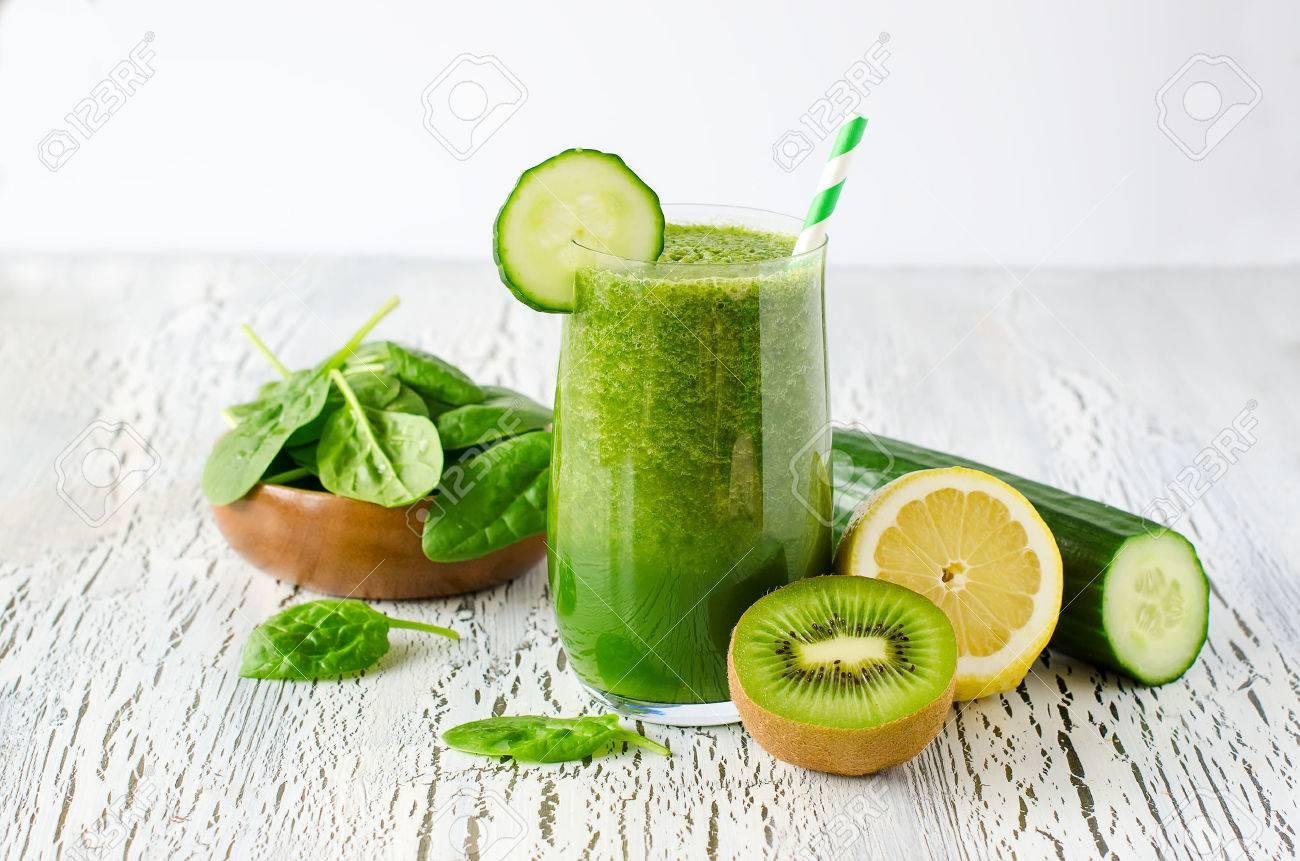 Fresh green detox smoothie on white wooden background, diet and health concept, vitamins - 42060060