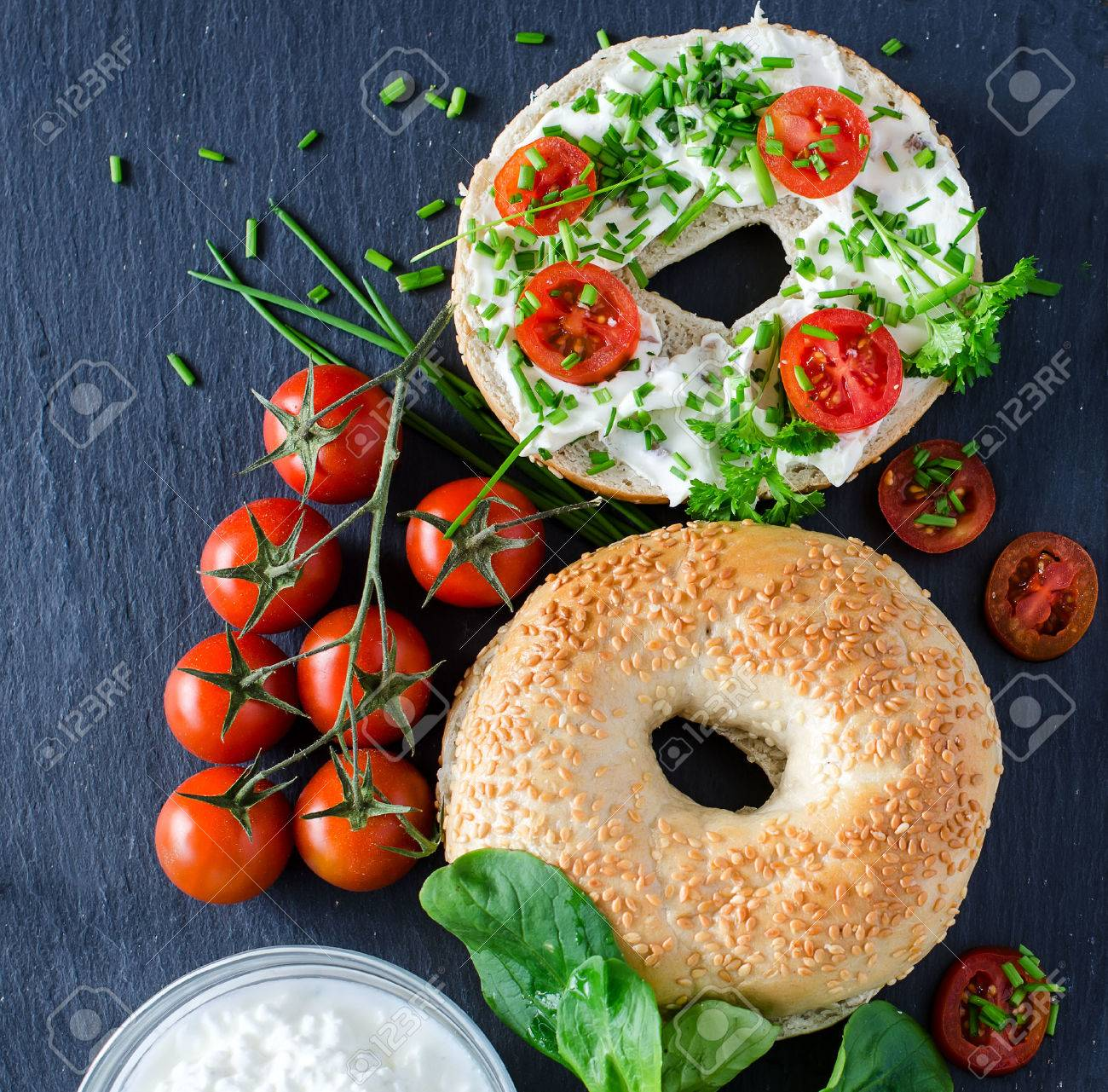 Bagels sandwiches with cream cheese, tomatoes and chives for healthy snack - 42641500