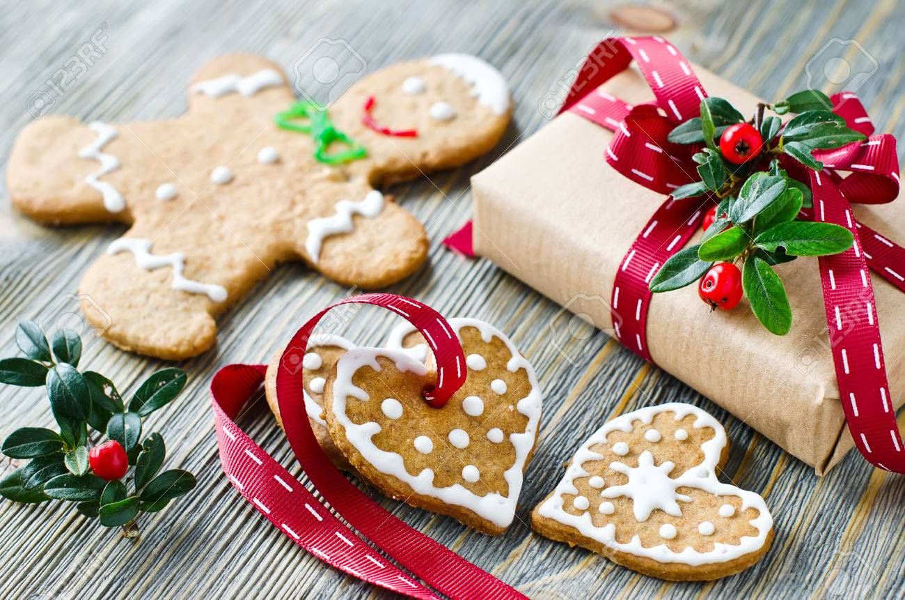 Gingerman and heart shaped cookies with icing decoration and a present box - 47415597
