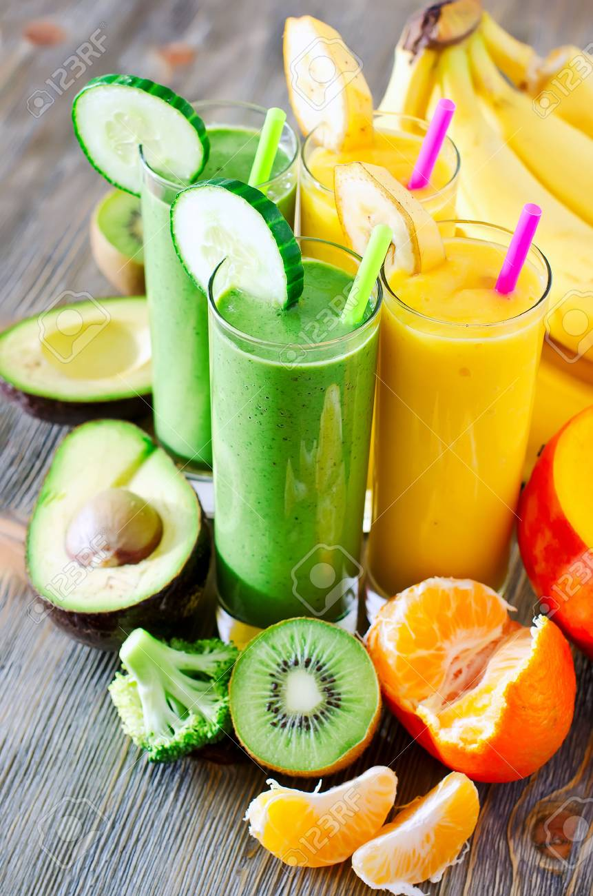 Healthy drink with fruits and vegetables on wooden table - 47448057