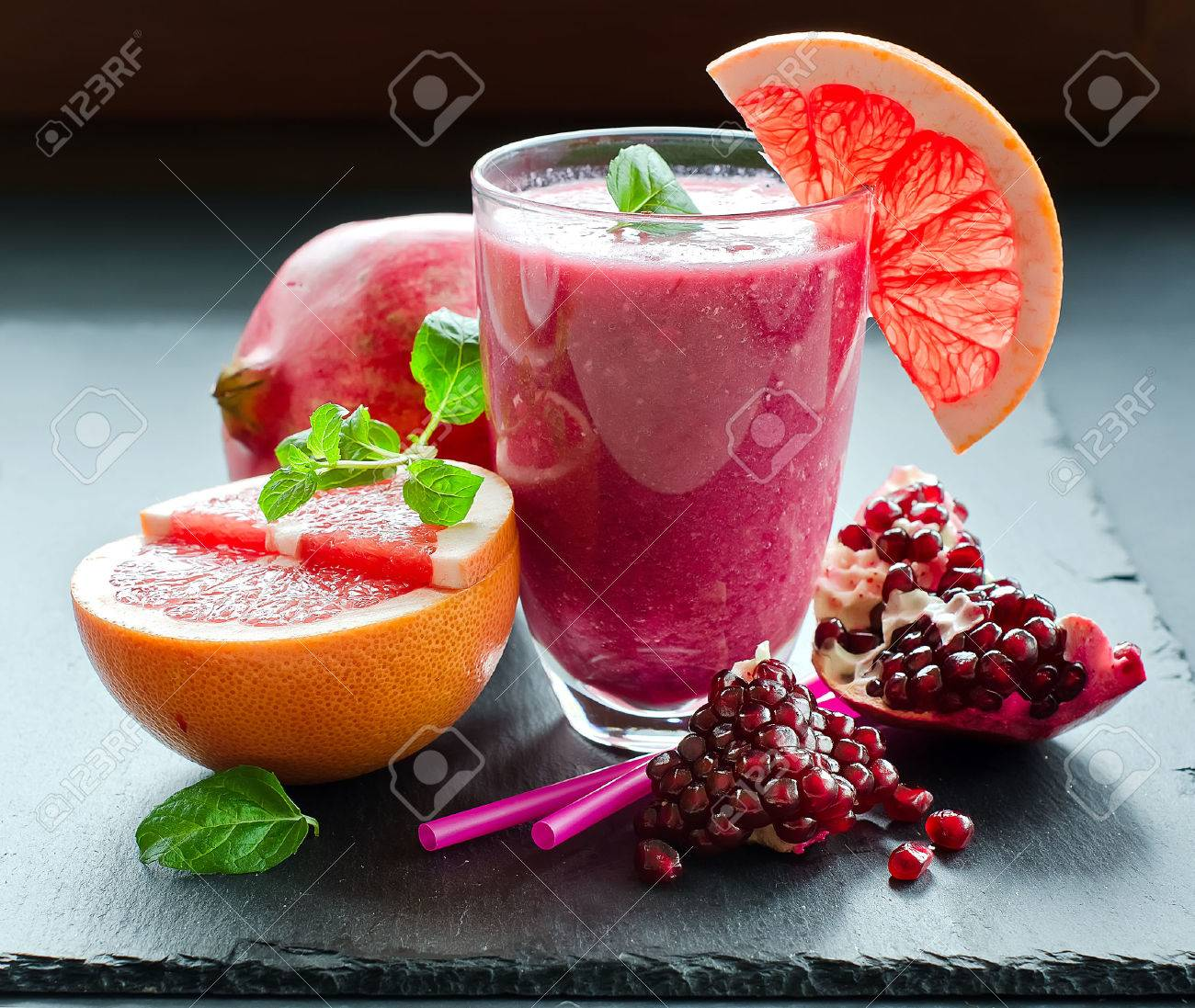 Red fresh smoothie with ingredients on black background - 47449942