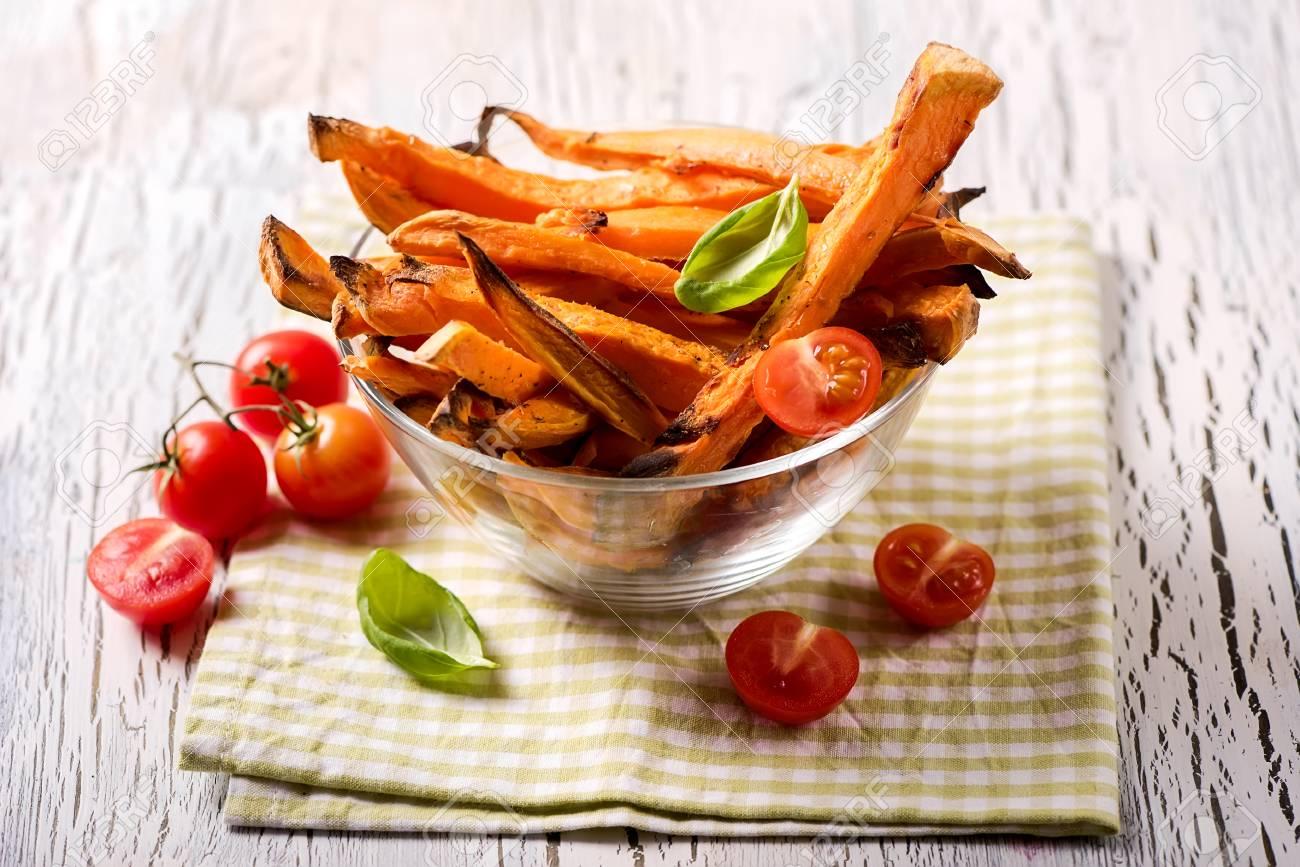 Healthy homemade sweet potato fries, vegan vegetarian snack - 72827569