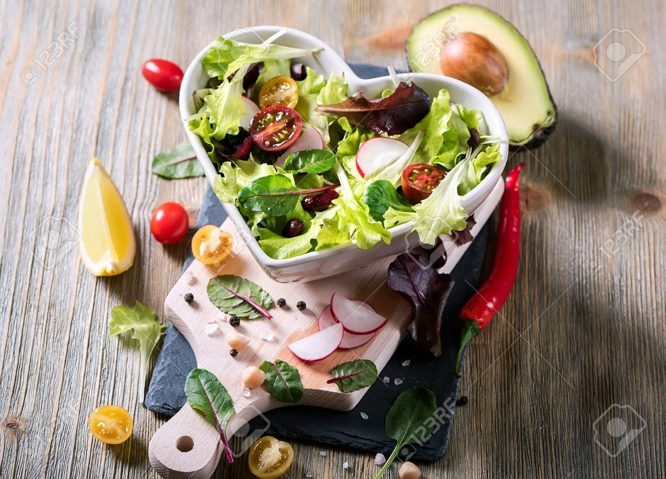 Healthy green salad with avocado, mangold leaves, red beans and cherry tomatoes. Vegan snack, vitamins, vegetarian food and diet concept - 74119582