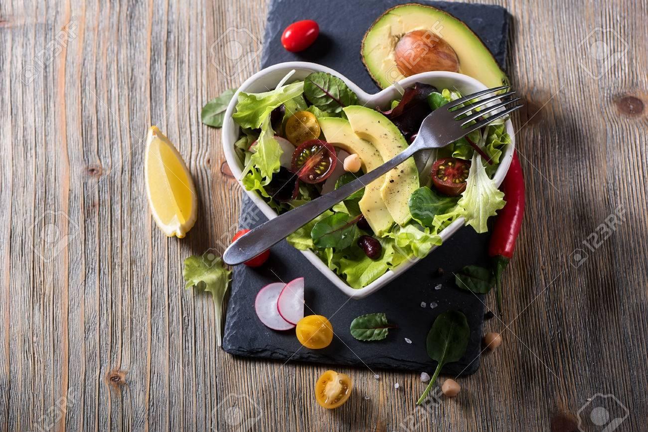 Healthy homemade chickpea salad with avocado and veggies, diet, vegetarian, vegan food, vitamin snack - 74213746