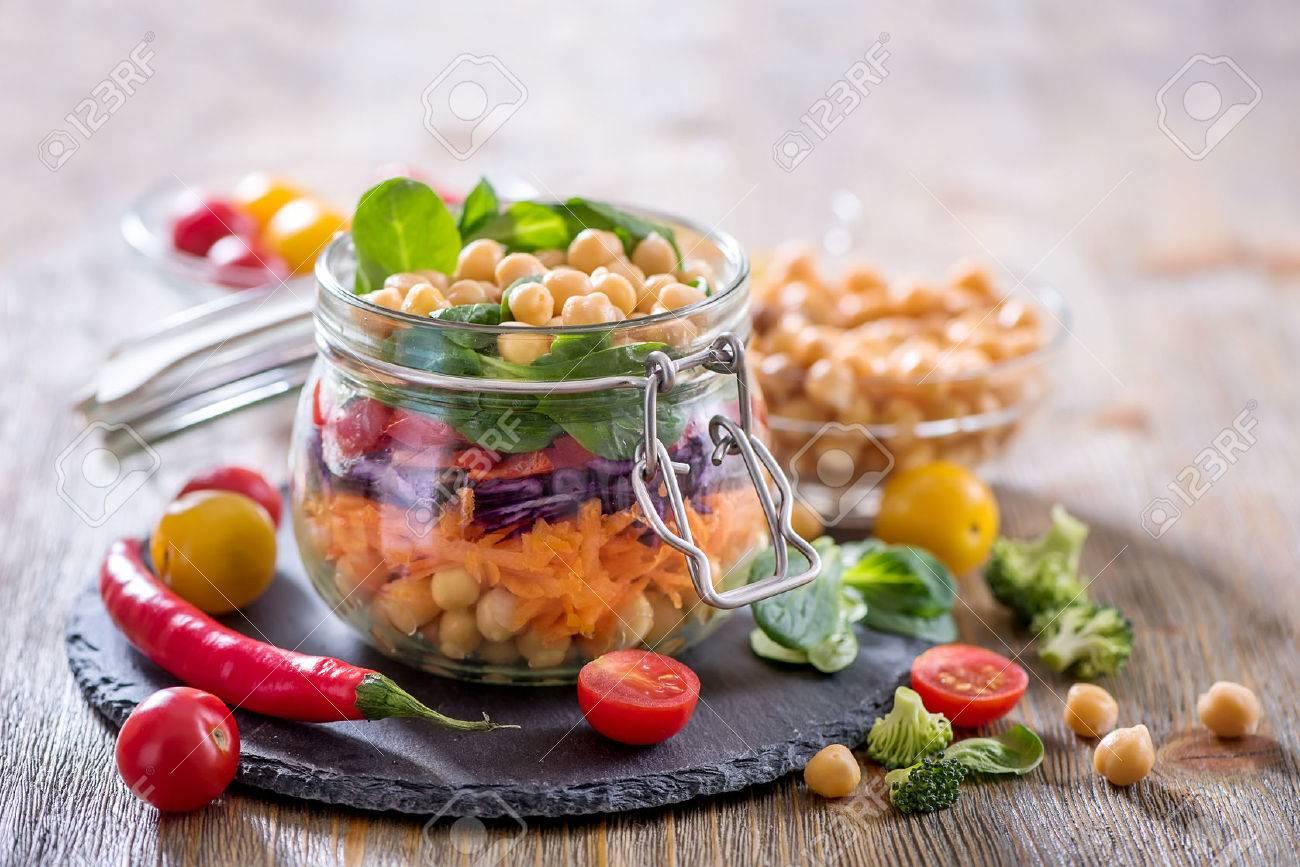 Healthy mason jar salad with chickpea and veggies, diet, vegetarian, vegan food - 78074490