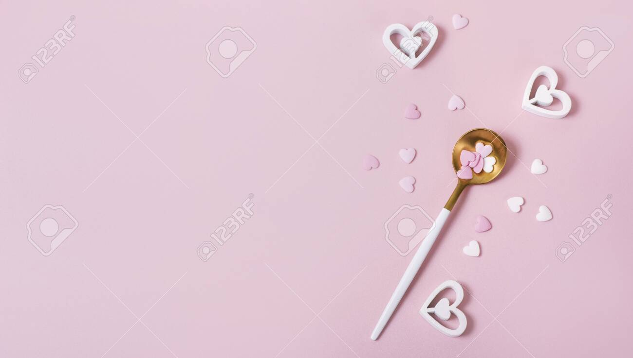 Spoon with hearts, pink romantic background, love symbols, top view, copy space for text, romantic eating concept - 141251661