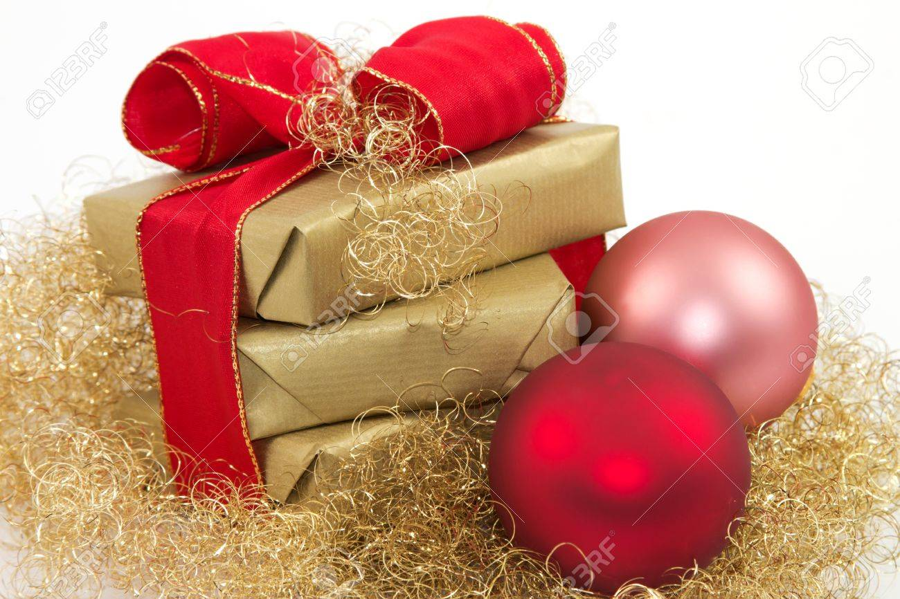 Three golden gifts and two Christmas balls with a white background - 11214516