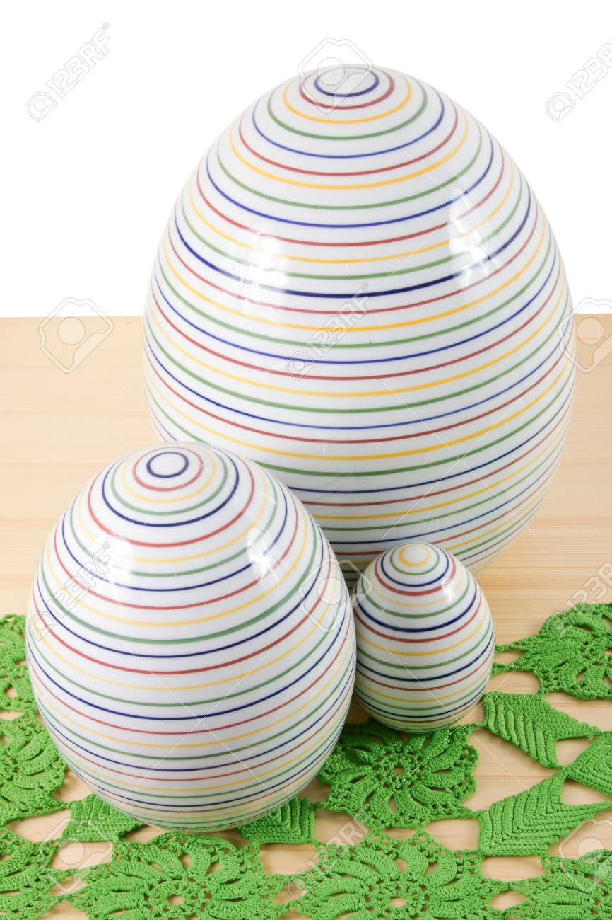 Wooden table with a green tablecloth and three Easter eggs Stock Photo - 12900885
