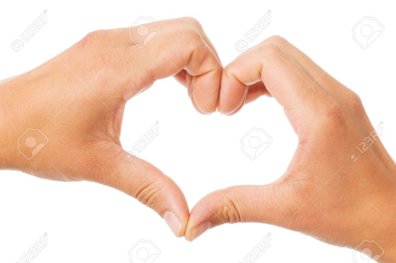 Two hands of a woman forming a heart shape over a white background Stock Photo - 14192228