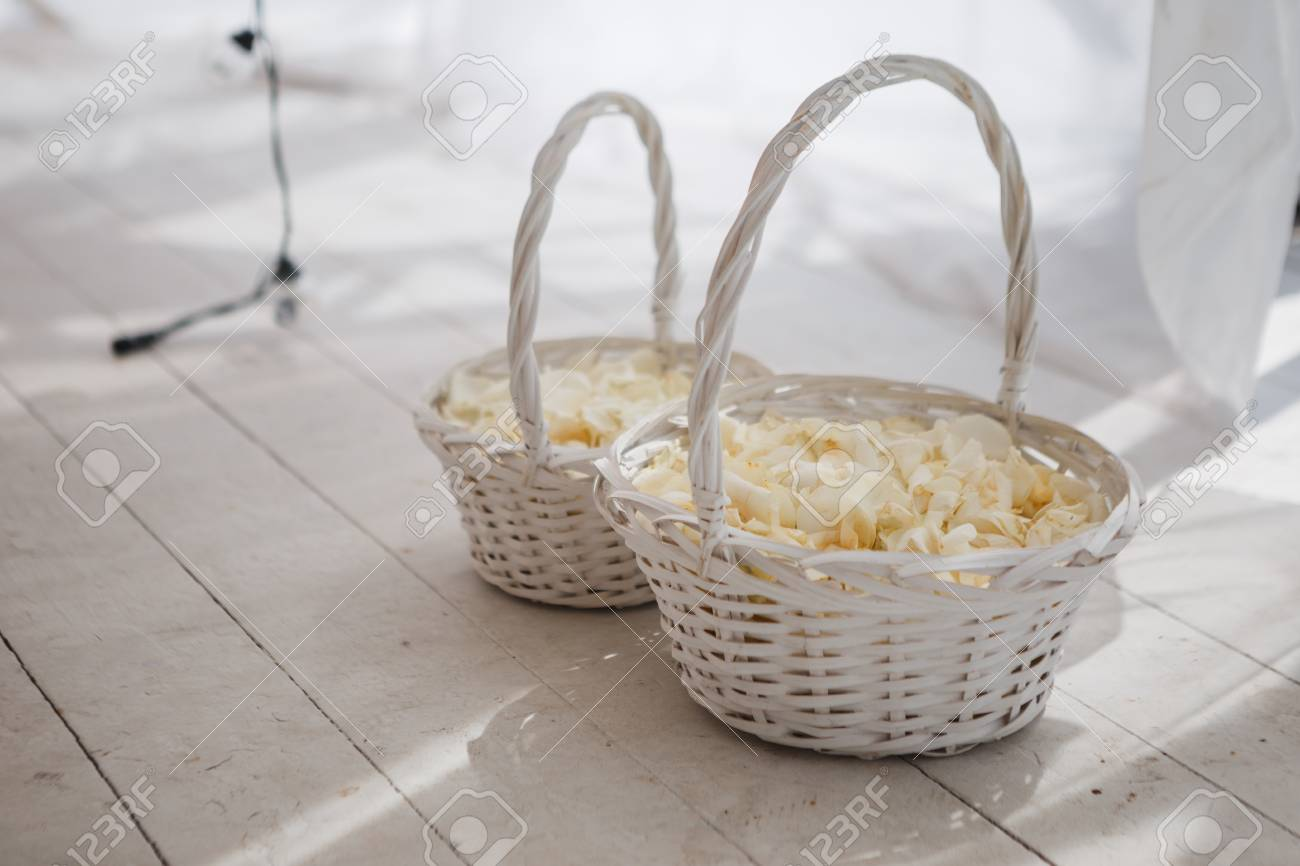 White Wicker Baskets With Rose Petals For Wedding Ceremony Stock