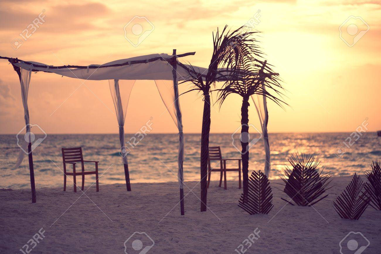 Beautiful Decorated Romantic Wedding Tent On Sandy Tropical Caribbean Beach At Sunset Stock Photo
