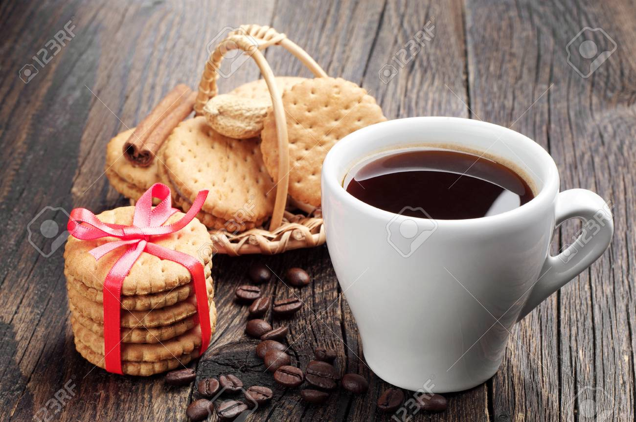 Cup of coffee and sweet cookies on a wooden table Stock Photo - 20689773
