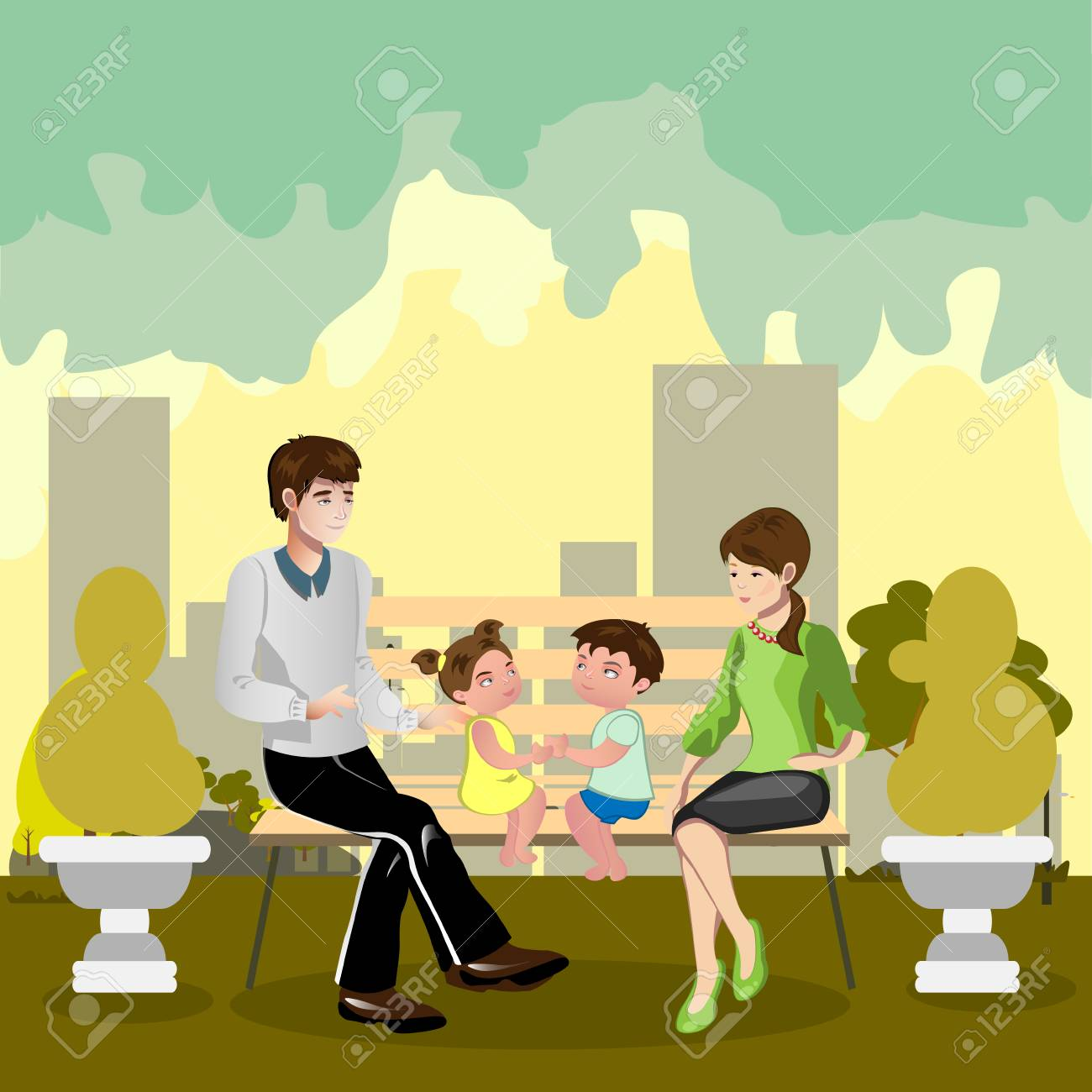 Family sitting in a park - 75276220