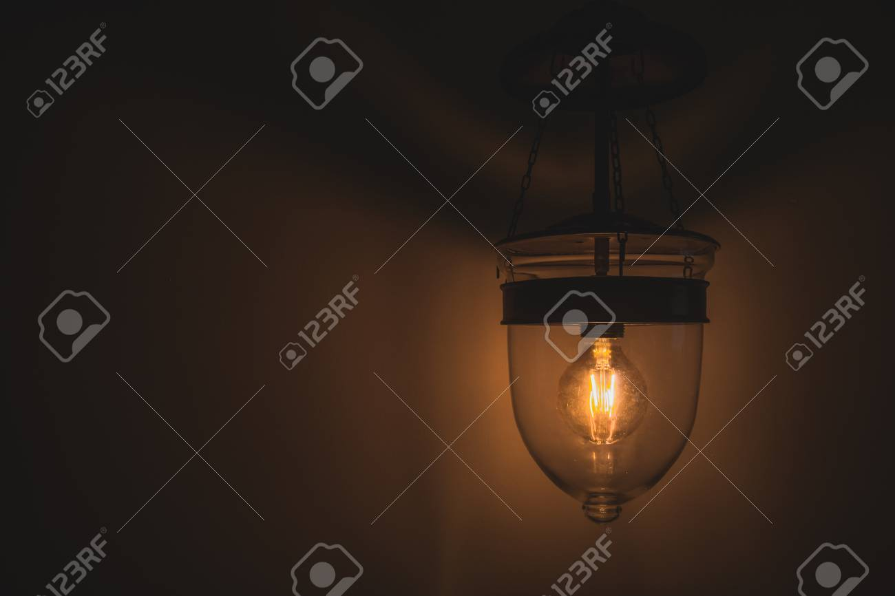 Stock Photo   Vintage Tone, Old Retro Edison Light Bulb With Dim Light