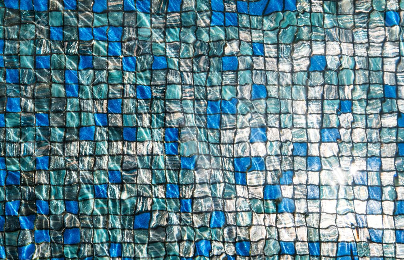 Blue Mosaic Tiles Under Swimming Pool With Rippled Water And.. Stock ...