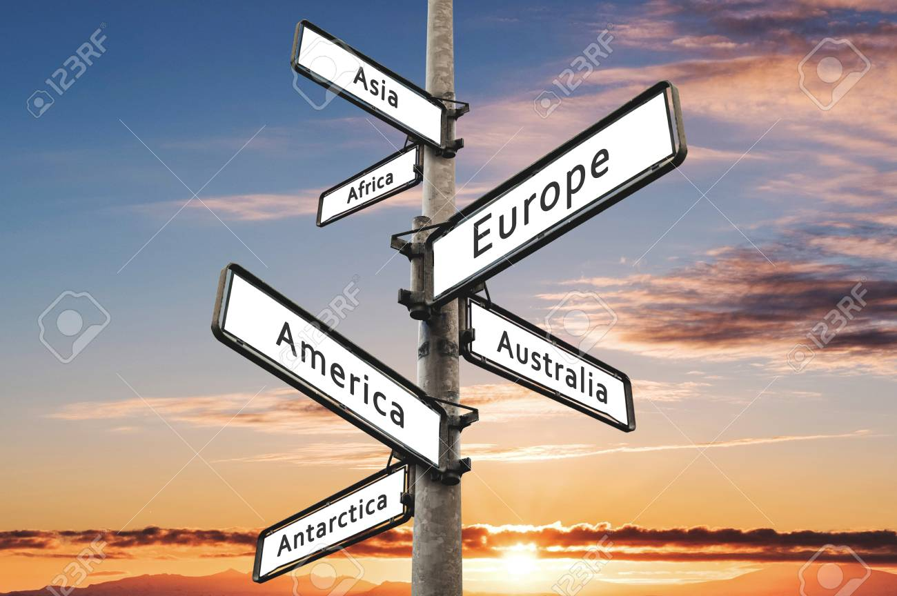 continents on road direction signpost with sunset sky background