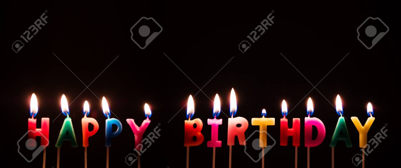 Colorful Happy Birthday Candles On Black Background Stock Photo