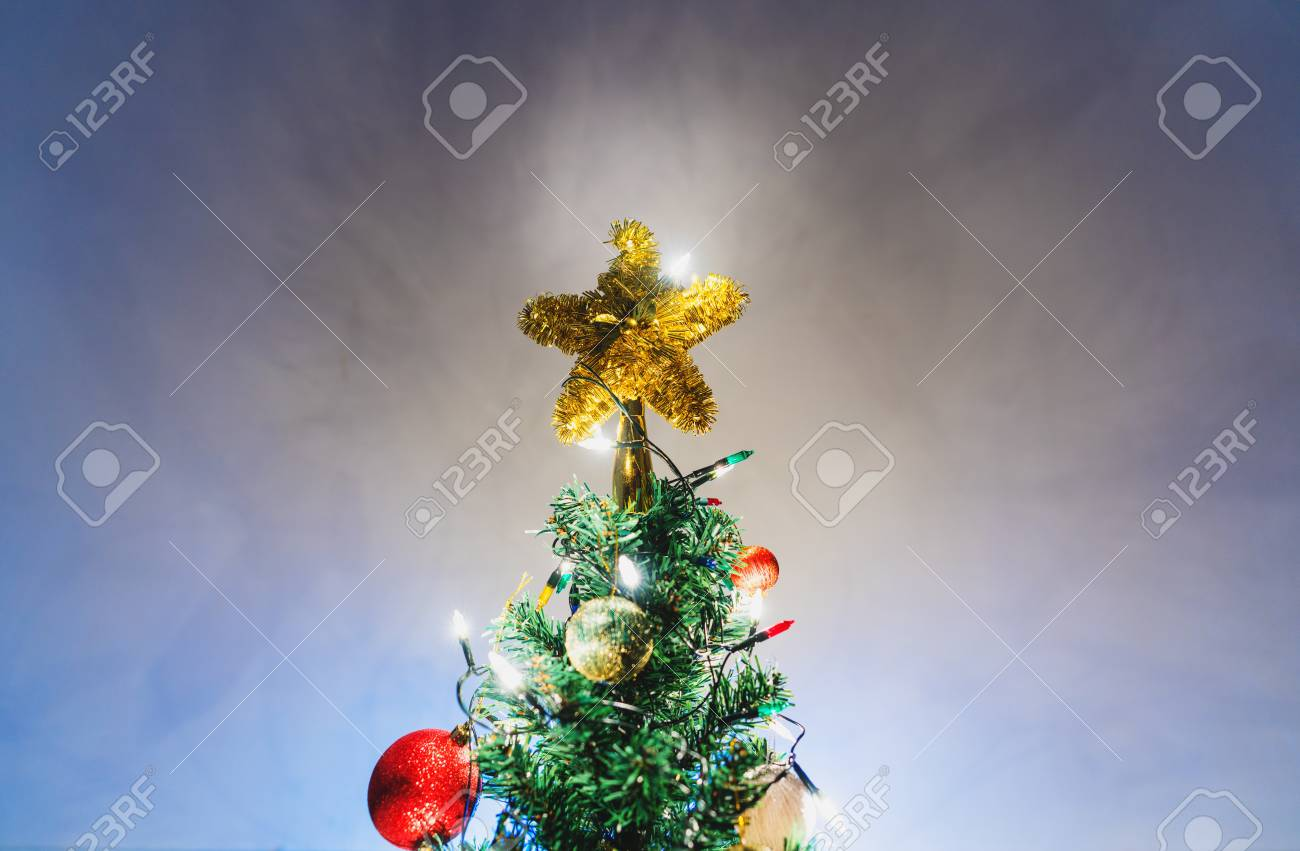 christmas star on christmas tree with decorations stock photo 92197658