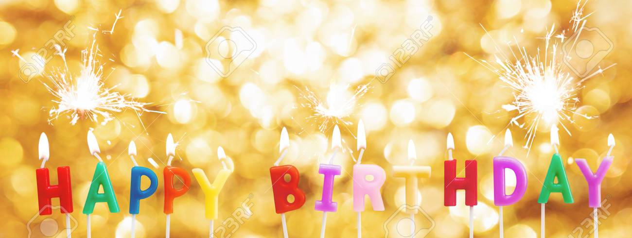 Happy Birthday Candles On Golden Bokeh Light Background With Sparkler Stock Photo