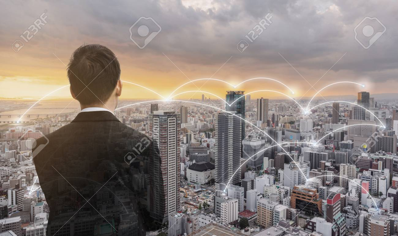 Network technology, logistics and blockchain business. Businessman looking city view in sunset - 119488318