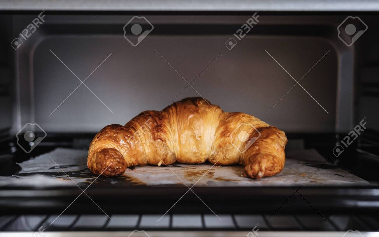 Fresh baked Croissant in oven - 146535195
