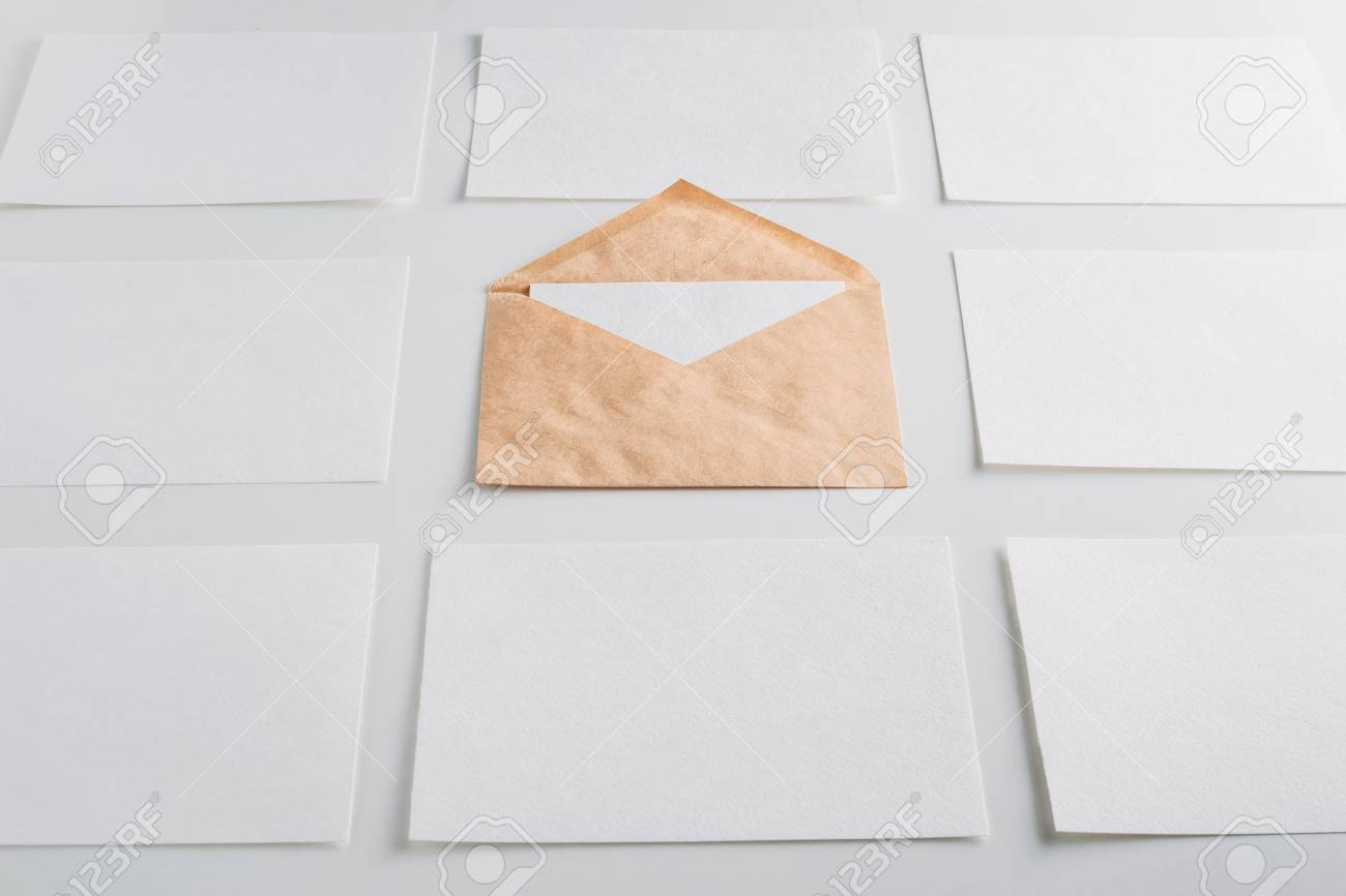 White Paper Empty Sheets Cards And Kraft Envelope On White
