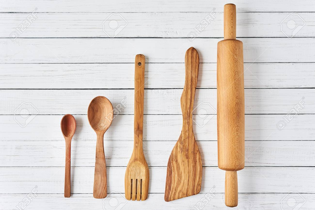 Wooden Kitchen Utensils On White Wooden Background With Copy