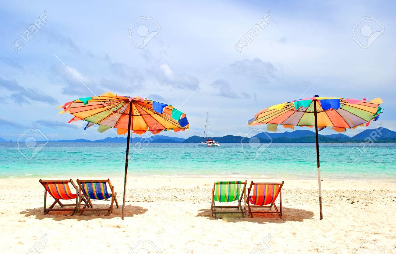 Beach chairs and colorful umbrella on the beach in sunny day Phuket Thailand Stock Photo & Beach Chairs And Colorful Umbrella On The Beach In Sunny Day ...